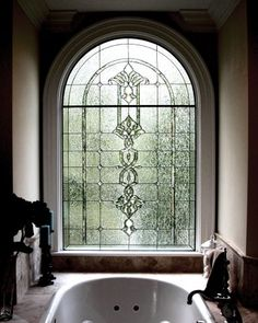 Traditional design with lots of bevels and clear Krinkle glass used in the background.  A pencil bevel arch within the clear stained glass placed emphasis on the architectural feature highlighting the spa effect of this room. Circle Top Window with complex bevel clusters and double  borders and obscure privacy background glass.