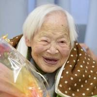 Record-holder: Misao Okawa, the world's oldest woman according to Guinness World Records, turned 115 on Tuesday in Osaka.   Maybe i'm related?? haha