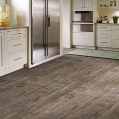 Black Mountain Oak LVS, a modern rustic w/natural distressing & fine sawn finishing: http://www.mannington.com/Residential/LuxuryVinylSheet/Wood/Black%20Mountain%20Oak/130170.aspx