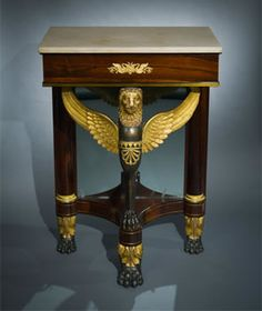 Attributed to Duncan Phyfe, Small Console Table with Lion Monopodia Support, about 1817-22. Rosewood, pine, gilded and painted verde antique, and ebony, with ormolu mounts, die-stamped brass inlay inset with rosewood, brass string inlay, mirror plate and marble, 36 ¼ high x 25 in. wide x 16 ½ in. deep. Photo: Eric W. Baumgartner.