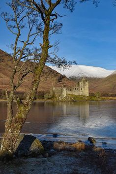 Kilchurn Castle on icy Loch Awe - by Anne Young