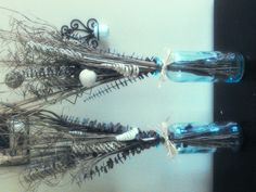 Arrangements in blue bottle glass for wedding reception