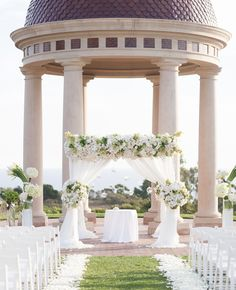 Combined with a bold palette and modern white touches like white flower petals and beautiful calla lily and hydrangea arrangements lining the ceremony aisle to the chuppah decorated with lush flowers.