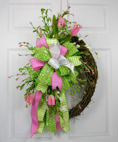 A versatile ready to use Terri Bow with Mother's Day accents. The Terri Bow has six different ribbons and is mixed with spring tulips and florals. This is a reusable wreath accent you can place on any