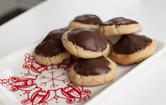 Peanut Butter Secrets...a mini peanut butter cup INSIDE a peanut butter cookie dipped in chocolate?! Can you say yum?! (And you'll be the hit of your cookie exchange and/or holiday gathering.)
