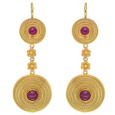 """Lalaounis Ruby Gold Pendant Earrings. Two-drop pendant earrings, designed as a larger disc-shaped element suspended from a smaller disc-shaped element, both accented by graduating circles of fine twistwire and centering a circular cabochon-cut ruby, the elements connected by two gold floral motif links, the earrings hanging from gold wires, mounted in 18k yellow gold, made in Greece, numbered H.17, with maker's mark for Ilias Lalaounis. 2.25"""" length and 0.78"""" width at widest point. 21st…"""