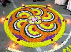 The Hindu celebration of Diwali - The festival of lights marks the end of the harvest season and welcomes the Goddess of Wealth, Lakshmi into homes.  Creating these Rangoli designs and accenting with the diyas (clay lights) are a major part of the celebrations.