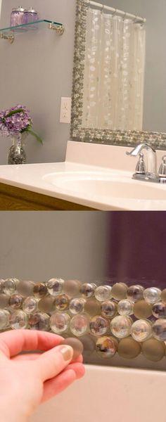 36. Stone Border Bathroom Mirror