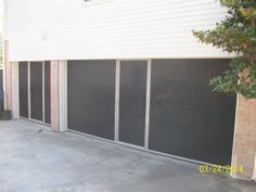 Two Lifestyle garage door screens in Oak Point Texas. Be the first in your town. coolscreenstexas@hotmail.com