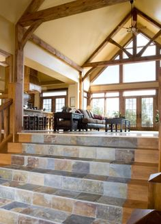 I LOVE the idea for the elevated living room, but I DON'T like the beams and walls! Custom Hybrid Log Homes & Timber-Frame Homes – Photo Gallery by Wisconsin Log Homes - Greatrooms - Wisconsin Log Homes