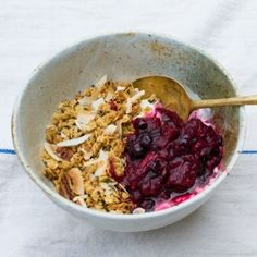 Pecan and coconut granola with roasted rhubarb and blackcurrants