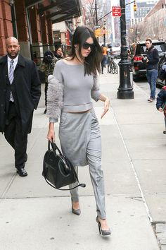 Who: Kendall Jenner What: A Pant/Skirt Hybrid Why: The model embraces an inspired monochrome look, pairing a fur-sleeve knit with trousers with a skirt overlay for a thoroughly modern fashion moment.  Get the look now: Rick Owens DRKSHDW skirt trousers, $533, farfetch.com.   - HarpersBAZAAR.com