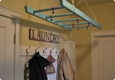 This would be great on a pulley above the table in laundry room- pull down to hang clothes, retract when not in use- cute, too!!