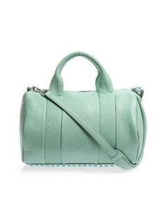 Alexander Wang has a sweet tooth this season, updating the signature Rocco bag in mint-green pebbled leather. Same-tone mirror-shine studs punctuate the bottom, so carry it cross-body to showcase them best.