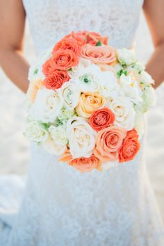 Coral #bouquet for the beach bride. Photography: Hana Chung Photography - www.hanachung.com  Read More: http://www.stylemepretty.com/destination-weddings/mexico-weddings/2014/09/02/destination-wedding-at-dreams-los-cabos/