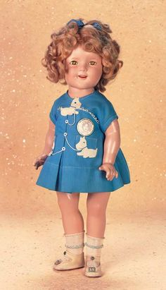 """*AMERICAN COMPOSITION SHIRLEY TEMPLE ~ by: Ideal in """"Our Little Girl"""" Costume, 18"""" T. All-composition doll w/ socket head, green sleep eyes....MARKS: Shirley Temple Ideal Co. NT Co. (head) Shirley temple 18 (torso). Excellent condition, The pretty dimpled child star wears her original blue pique dress w/applique Scotty dogs from """"Our Little Girl"""" film of 1935, along w/original undergarments, socks + shoes."""