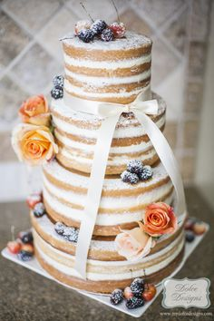Love this!!!! Because i dont like feosting.naked wedding cake by Dolce Designs in houston