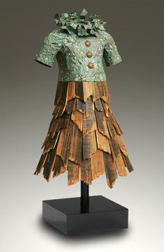 "Yardsticks, shingles, playing cards and bottle caps. These are the building blocks of sculptor John Petrey's collection of nostalgic dresses, inspired by his favorite 1960s sitcom mothers. This one is ""Bethany"" made from Tiffany patina copper and  vintage barnwood and is 27""T x16""Wx16""D   see more - you'll love it...  www.johnpetrey.com/gallery.html?gallery=THE DRESS SERIES"