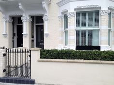 front garden wall and rail victorian moasic tile path black grey and white metal gate and rail fulham chelsea london