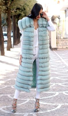 Fox Fur with whole skins. Made in Italy. Skins Quality: SAGA ROYAL FURS; Color: Tiffany; Closure: With zip; Collar: Shawl; Lining: 100% Satin; Lining Color: Monocolor; Length: 120 cm;