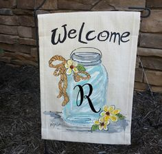 Garden Flag, Vintage Mason Jar, Yard Art, Gardening, personalized,Landscaping, Home Decorations, Patio, Housewares, Hand-painted, No 207 Garden flag is made of 100% medium weight cotton canvas fabric and is signed by the artisan. The flag is 13 inches wide and 18 inches tall with a 3 inch tab on top to slide onto to most flag posts. **NOTE** This listing is for the garden flag ONLY. **NOTE** If using outside we do suggest spraying with scotch guard. Special request: Let us do a custom ord...