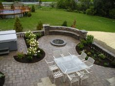Patio with fire pit, seat wall and planting beds