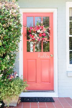 front porch makeover! Coral door really pops!