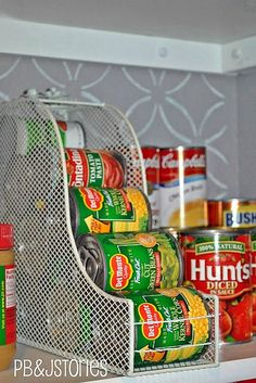 Use a magazine rack stored on its side for inexpensive canned food storage like this one from PB & J Stories.