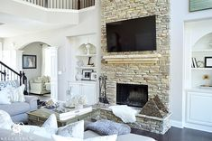 Kelley Nan (@kelleynan) • Instagram photos | neutral white and gray living room with two 2 story  stacked stone fireplace and white built ins | living room and great room ideas KELLEYNAN.com