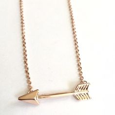Rose gold plated arrow necklace New! 18 inch rose gold plated boho arrow 18 inch necklace. Bundle and save 15%. No trades. Arrow 1 inch long. Minimalist boho chic Jewelry Necklaces