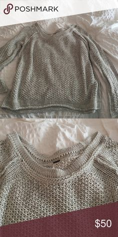 Free People sweater size M Cotton open weave sweater. Large scoop neck that falls so it will be off the shoulder. Really easy and looks great layered with cute cami or tank as it's intentional to be worn this way. Free People Sweaters Crew & Scoop Necks