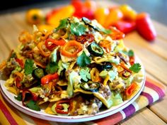 Kicked Up Breakfast Nachos with Fluffy Eggs, Avocado Cream & Roasted Peppers from NoblePig.com
