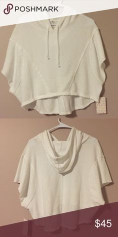 Free People hoodie NWT ! Super cute Lost and Found hoodie in white active wear. Free People Tops Sweatshirts & Hoodies