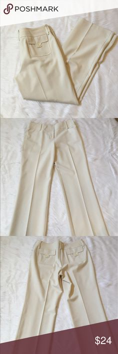 """Loft Dress Pants This is a pair of Ann Taylor Loft Petite Dress Pants in EUC. They are a light cream color and are fully lined. They have a very tiny spot as seen in the last picture, shown close up. The inseam is 29"""". Materials are 63%polyester, 33%rayon and 4%lycra/spandex. Lining is 100% acetate. ⚜Please see my """"reasonable offers"""" listing at the top of my page before submitting an offer⚜Thank you😊 LOFT Pants Trousers"""