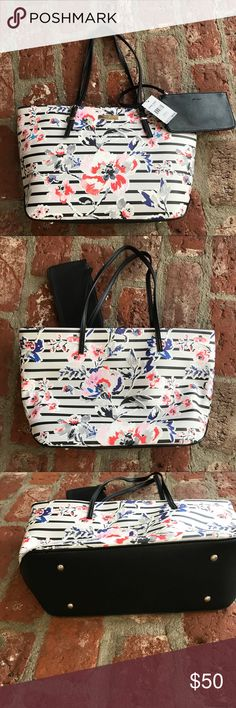 Nine West IT GIRL flowered tote 👜 Fashionable and sophisticated!  This faux leather tote is awesome!  Beautiful flowers in gray, red, pink, blue and black. Made in China of man made materials. Top zip closure and protective metal feet at base. Removable black zip pouch measures 7.5 inches wide and 4 inches tall with wristlet. Thin straps with faux buckle details and 9.5 inch drop. Inside fabric lining with zip pocket, center zip pocket and two slip pockets. Dimensions are 28 inches wide by…