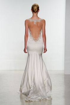 Lace, buttons, and an open back. What else does a wedding dress need? From the Kenneth Pool spring 2015 bridal collection.