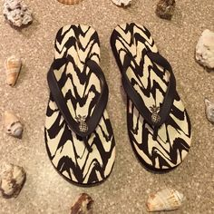 Tommy Bahama Flip Flops Beach worthy flip flops from Tommy Bahama. Size 6. Fits true to size. Color brown. Inside of flip flop is brown and white. Pineapples are silver with black little jewels. NO TRADES. PRICE FIRM. Tommy Bahama Shoes Sandals