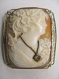 ( Frankly I've never cared for those with the diamond added but this is a good example.  If you own an old cameo it is good to gently wipe it with a good quality oil, such as olive oil, about once a year.  These shells do dry over time and can crack which takes away from the beauty as well as the value.)jw
