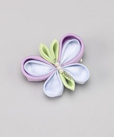 hair flower designs..flowers, bugs, doodles. Alligator clips on to crocheted hats or headbands or simply hair!