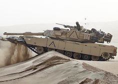 """""""First produced in 1983. Top speed: 42 mph. Range: 289 miles. The Textron AGT 1500 gas turbine engine gives Abrams a power-to-weight ratio of 26.64 horsepower per ton. Armor thickness: classified. Primary armament: 120-mm M256 gun.     The M-1 scores full marks for firepower and armor - it is the match of any of today's top tanks."""""""