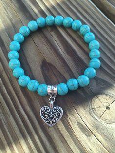 Bracelet turquoise avec breloque coeur par CrumbsOfJoy sur Etsy Gemstone Bracelets, Handmade Bracelets, Jewelry Bracelets, Coin Jewelry, Beaded Jewelry, Jewellery, Bracelet Turquoise, African Bracelets, Little Girl Jewelry