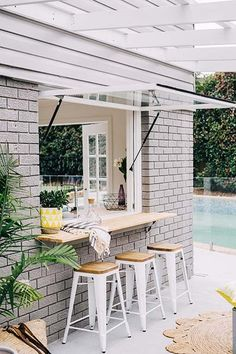 Outdoor bar stools // pool bars for the home // chic outdoor spaces Pool house! Outdoor bar stools // pool bars for the home // chic outdoor spaces Pool house! Outdoor bar stools // pool bars for the home // chic outdoor spaces Style At Home, Beach House Style, Future House, Outdoor Spaces, Outdoor Living, Outdoor Kitchens, Indoor Outdoor Kitchen, Rustic Kitchens, Outdoor Bar Stools