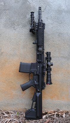 AR-15 gen 5 2012 special edition via newark firearms. Specially modded with slick-shift barrel, stock interchange, jump-cut fire rate and manual switch. Optional mount for electric rds and laser sight. So much awesomeness rolled into one package! I want this sooo bad haha. J. Malan