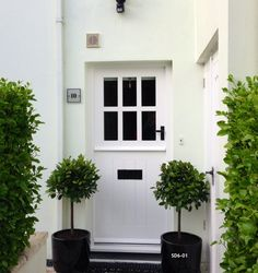 stable door with six panes painted white. Many other colours available - made to measure from solid wood. Delivery throughout the UK and Europe