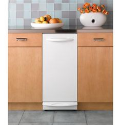 Our GE Profile Series compactor has a powerful motor and a rich, contemporary look. Controls are hidden behind the compactor door to keep your kitchen design seamless.