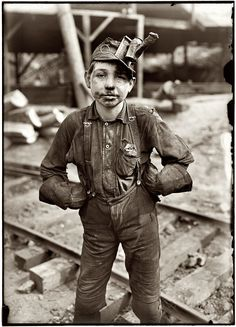 """Tipple Boy: August 1908. Tipple boy at the Turkey Knob coal mine in Macdonald, West Virginia. Says the LOC: """"Patron identifies this as her grandfather, Otha Porter Martin, born July 3, 1897."""" Photograph by Lewis Wickes Hine."""