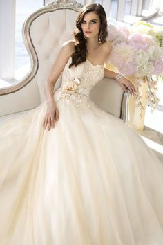 Stunning, off white, ball gown style wedding dress. Strapless, lace bodice with ribbon, and rose accent at natural waist.
