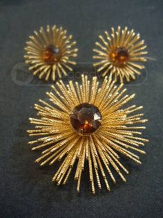 Sarah Coventry Burst brooch and earrings...check Grandma's jewelry box for gorgeous vintage costume jewelry