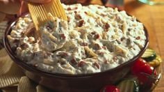 Hidden Valley Bacon & Cheddar Dip  Ingredients  ¼ cup crisp-cooked, crumbled bacon*   1 container (16 ounces) sour cream   1 cup shredded Cheddar cheese   1 packet (1 ounce) Hidden Valley® Original Ranch® Dips Mix   Potato or corn chips, for dipping      Instructions  Combine dips mix with sour cream. Stir in cheese and bacon. Chill at least 1 hour. Serve with potato or corn chips.