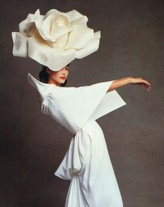 """The last pinner said: """"Christy Turlington, Vogue 1992."""" -- I really like the giant rose as a fashion picture... the dress she's sporting is also a really interesting style, and she's quite pretty yet, she's got a cheeky look about her. Over-all I rather enjoy this image."""